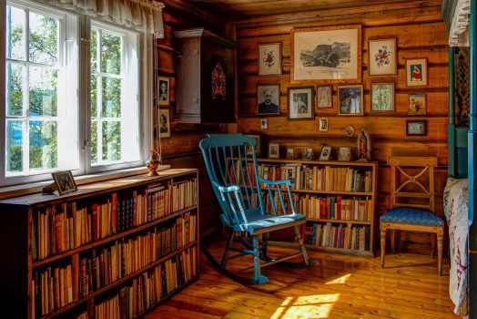 Sigrid Undset rocking chair and books stand as if she is just out for a walk. Photo - Ian Brodie Bjerkebæk
